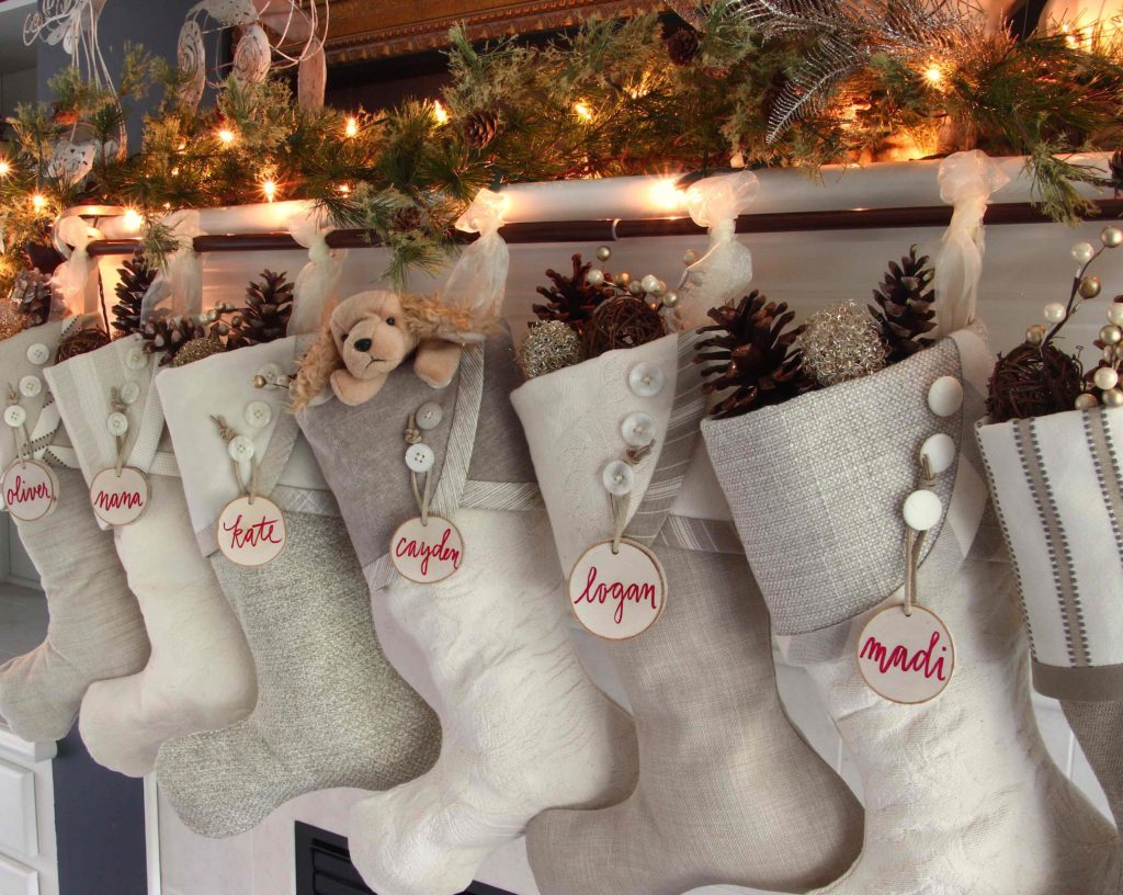 Eggnog and cream Christmas stockings with white birch tree slice name tags